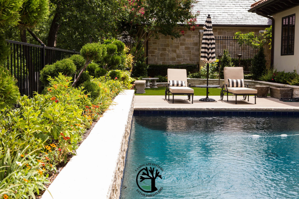 Making Your Backyard An Oasis Pool Landscaping Design